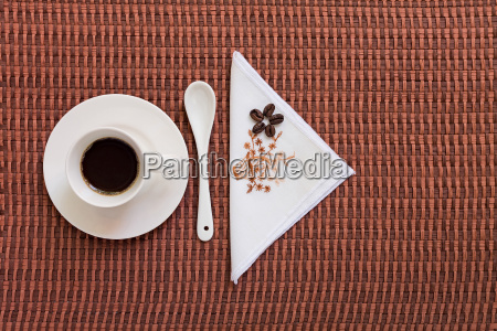 coffee on tablecloth with coffee beans