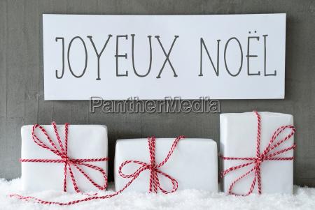white gift on snow joyeux noel