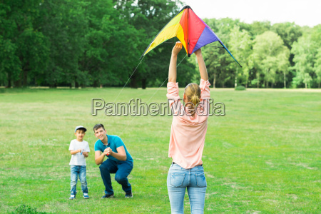 family flying the kite together