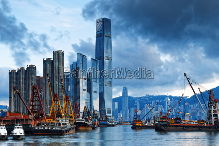 hong kong harbor with cargo ship