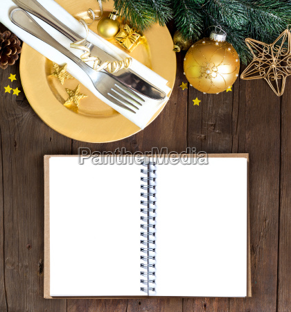 festive table setting with notebook
