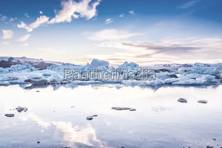 scenic view of icebergs in glacier