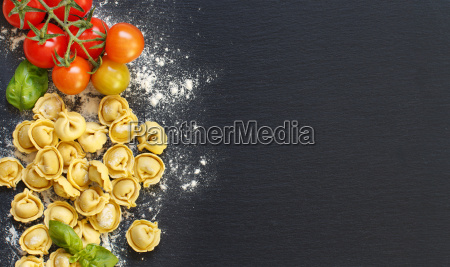 fresh tortellini with basil ad tomatoes
