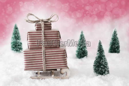 christmas sled on snow with pink