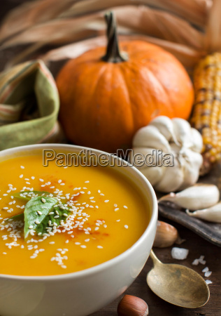 fresh pumpkin soup and vegetables