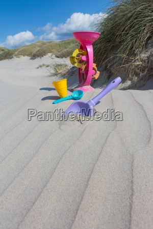 playing in the sand on the