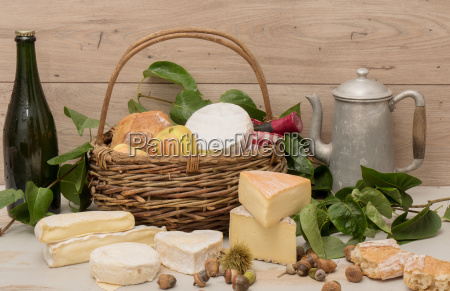 french cheeses with a bottle of