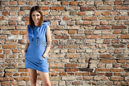 woman in blue dress against a