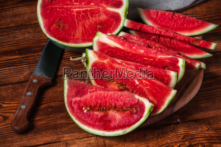 watermelon slices with knife lying on