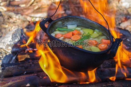 vegetables prepared in a cauldron over