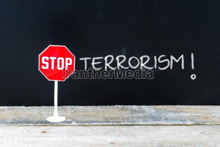 stop terrorism message written on chalkboard