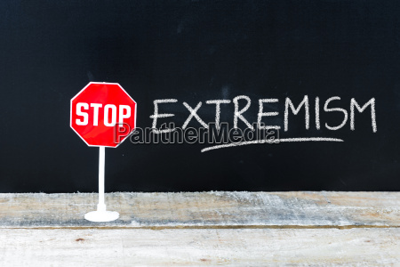 stop extremism message written on chalkboard