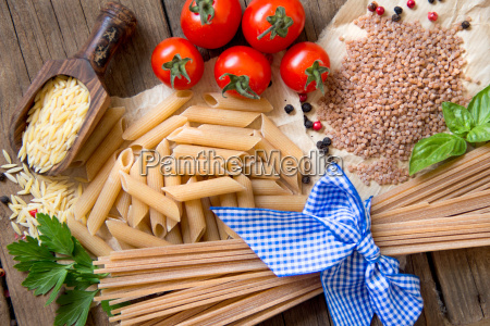 pasta tomatoes basil and parsley on