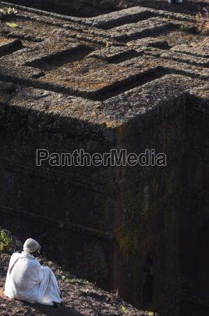 pilgrim in traditional white shawl at