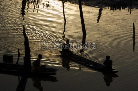 boats at dusk meekong river laos