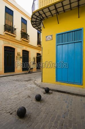 yellow wall blue shutters havana cuba