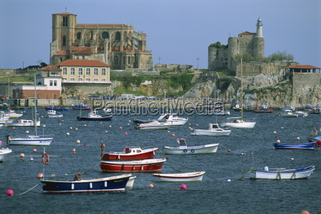 boats moored in harbour and the