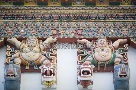 painted figures on gangtey gompa monastery