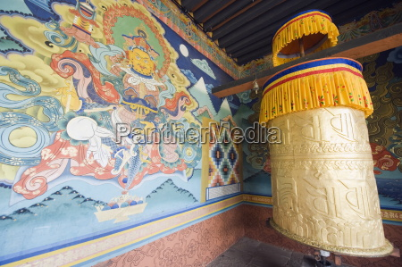 wall painting and prayer wheel punakha