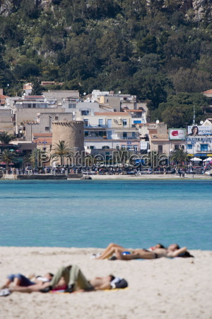 sunbathers on beach mondello palermo sicily