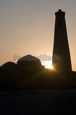 silhouette of minaret in the setting