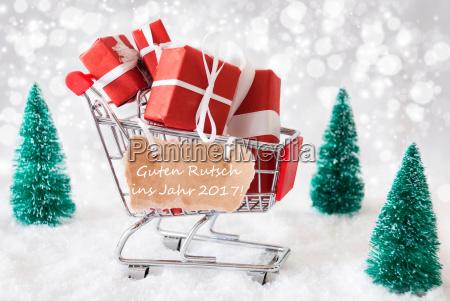 trolly with christmas gifts guten rutsch