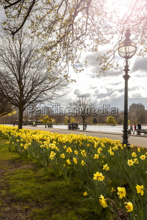 visitors walking along the serpentine with