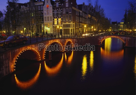 illuminated bridges reflected in the canals