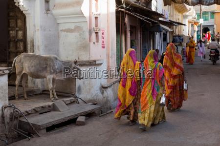 ladies in traditional dress walking past