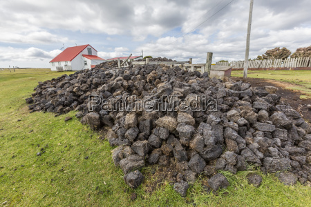 peat drying in the wind for
