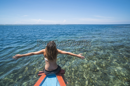 woman on a traditional indonesian boat