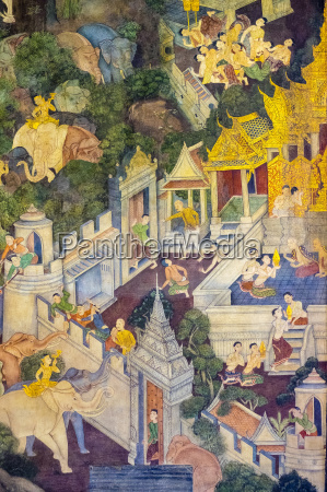 colorful painted murals depicting scenes from