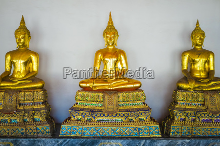 golden buddha statues wat pho temple