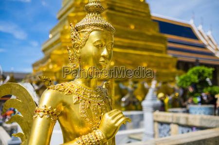 kinnara statue at temple of the