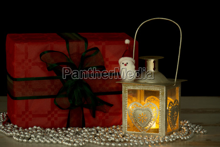 christmas gifts and a lantern with