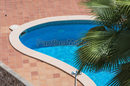 outdoor pool with blue tiles