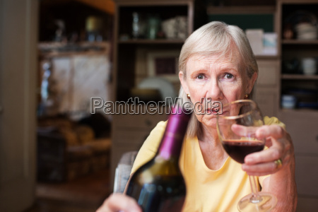 lonely female alcoholic offering wine