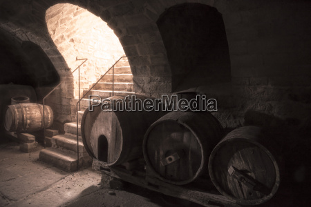 old wine cellar with wooden barrels