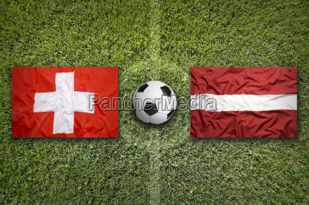 switzerland vs latvia flags on soccer
