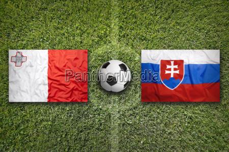 malta vs slovakia flags on soccer