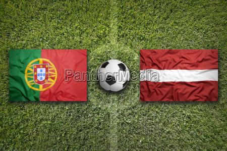 portugal vs latvia flags on soccer