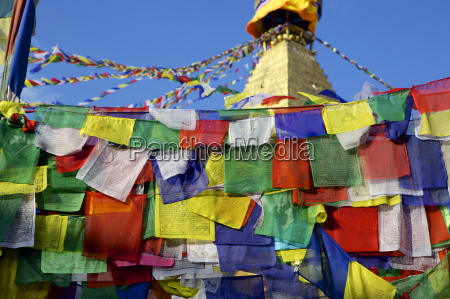 prayer flags in front of boudha
