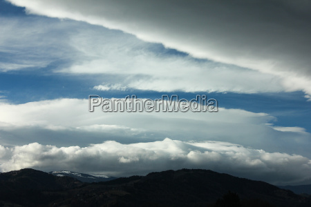 dark storm clouds at partially blue