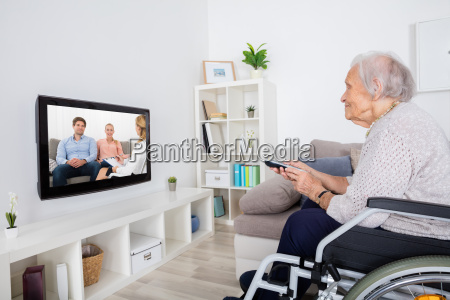 handicapped grandmother watching movie on television