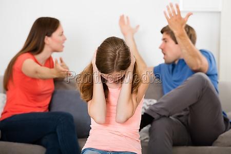 upset girl in front of parent
