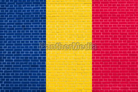 flag of chad on brick wall