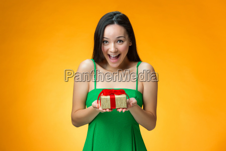 chinese, girl, with, a, gift - 19115671