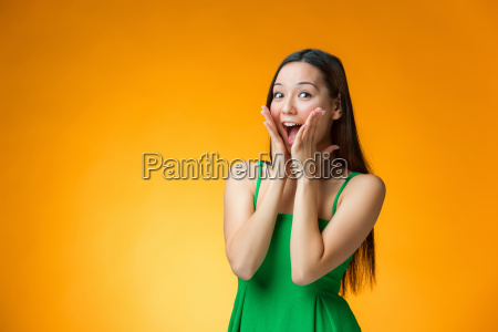 the, surprised, chinese, girl, on, yellow - 19115663