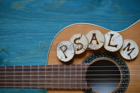 guitar on blue green wood with