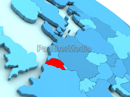 belgium in red on blue globe